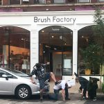 """Team Sigourney Reaper """"Beats the Street"""" in front of our October Crawl partner Brush Factory Furniture!"""